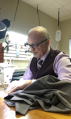 Master Rudolf Tailor Working with Sewing Machine